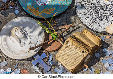Small cross and old bible at the hill of crosses
