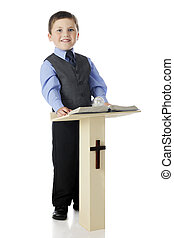 Boy Preacher - A dressed up elementary boy smiling from his...