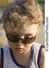 Boy in sun glasses closeup