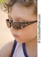 Boy in sun glasses macro