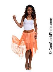 black woman with orange sheer dress