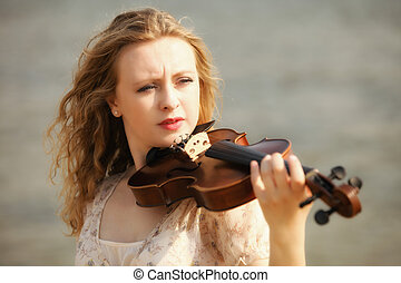 Portrait blonde girl with a violin outdoor - Portrait of...