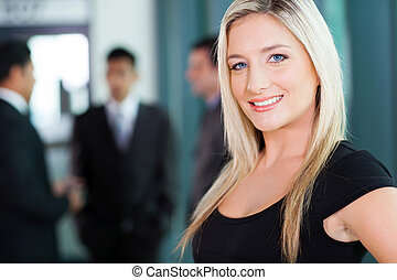 young businesswoman in office - beautiful young...
