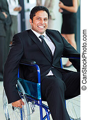 optimistic handicapped businessman in a wheelchair