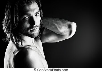 brutal man - Portrait of a sexual muscular nude man posing...