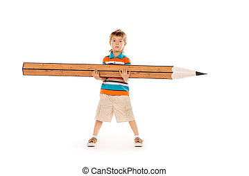 diligence - Cute boy standing with a huge pencil Education...