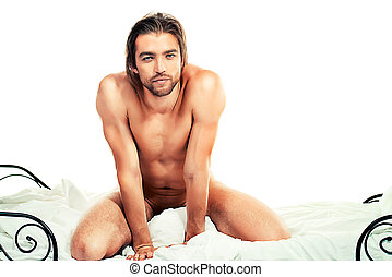 unshaven - Handsome nude man sitting on a bed Isolated over...