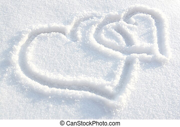 Two heart drawn on white-blue snow