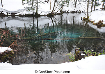 blue pond at Kaminokoike Hokkaido Japan