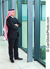 arabian businessman inside an office building - thoughtful...