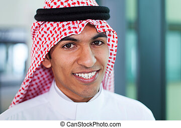 middle eastern corporate worker in office - young middle...