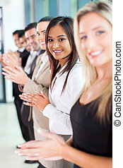 group of business team applauding - group of cheerful...
