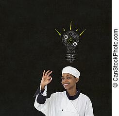 Gear cog lightbulb idea African woman chef on chalk...