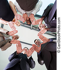 business team hands together - low angle view of business...