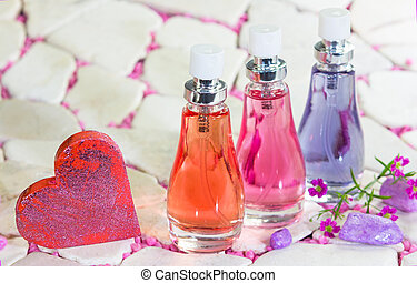 Three bottles of floral fragrance perfume