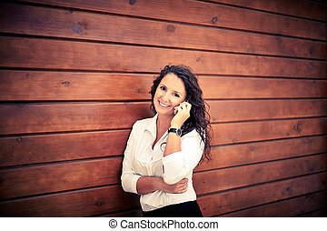 Business call - Image of happy businesswoman looking at...