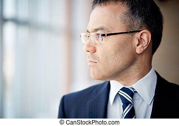 Pensive businessman - Portrait of thoughtful businessman...