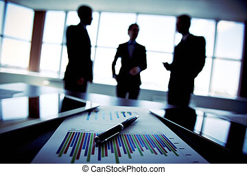 Business trio - Shadowy business trio holding a briefing...
