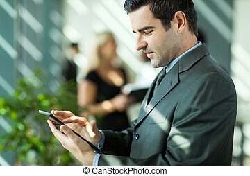 businessman using tablet computer - handsome businessman...