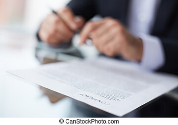 Terms of the contract - Shallow dof image of a businessman...