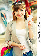 Cashless shopping - Vertical portrait of an attractive young...