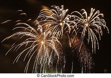 Celebratory fireworks display in a clear black sky. New...