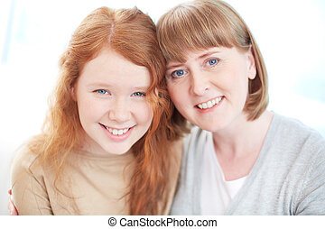 Parent and child - Isolated portrait of a cheerful family...