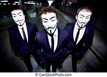Masked guys - Portrait of three guys in Guy Fawkes masks...