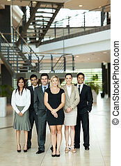 group of business people in modern office - full length...
