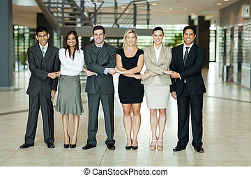 group of business people holding hands - cheerful group of...
