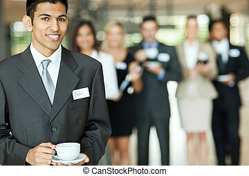 indian businessman having coffee break - smiling young...
