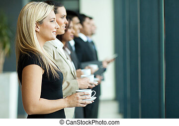 business people having coffee break - group of business...