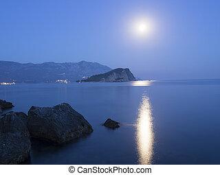 Montenegro night - moonlight over StNikola island in Budva,...