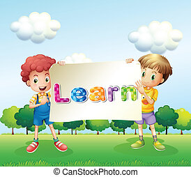 Two boys holding a banner that has words on it