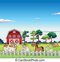 Animals inside the fence with a barnhouse at the back
