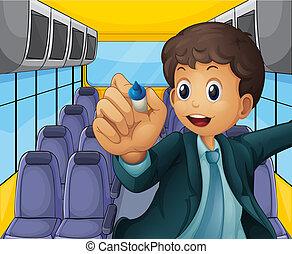 A boy holding a pen