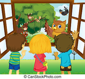 Three kids watching the different animals in the forest