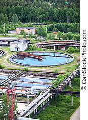 Round settlers in water treatment plant in summer, outdoors