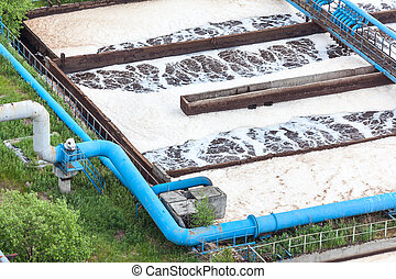 Blue pipelines with oxygen supply for water aeration in an industrial plant