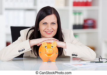Successful woman with her piggy bank - Successful smiling...