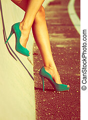 high heel shoes - woman tan legs in high heel green shoes...