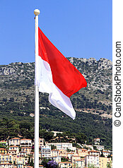 Monaco flag at Monaco - Monaco flag behind a Panoramic View...