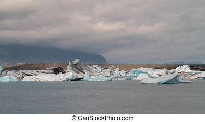 blue icebergs floating - Linear view Time lapse of blue...