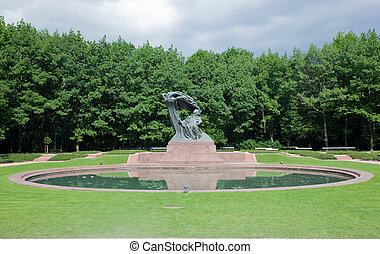 The Chopin Statue in Lazienki Park, Warsaw, Poland - The...