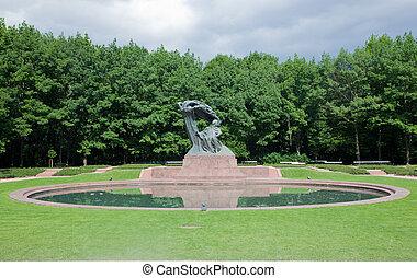 The Chopin Statue in Lazienki Park, Warsaw, Poland. - The...