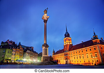 Old town in Warsaw, Poland at night The Royal Castle and...