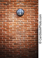 red brick wall and light lamp use for multipurpose