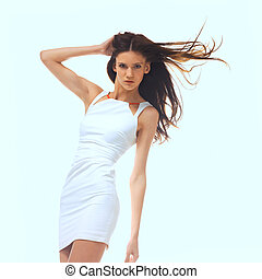 young woman in white dress - picture of young woman posing...