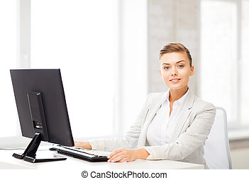 businesswoman with computer in office - picture of smiling...