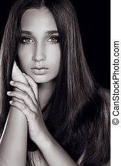 Fashion portrait of attractive woman with beautiful eyes, black and white photo